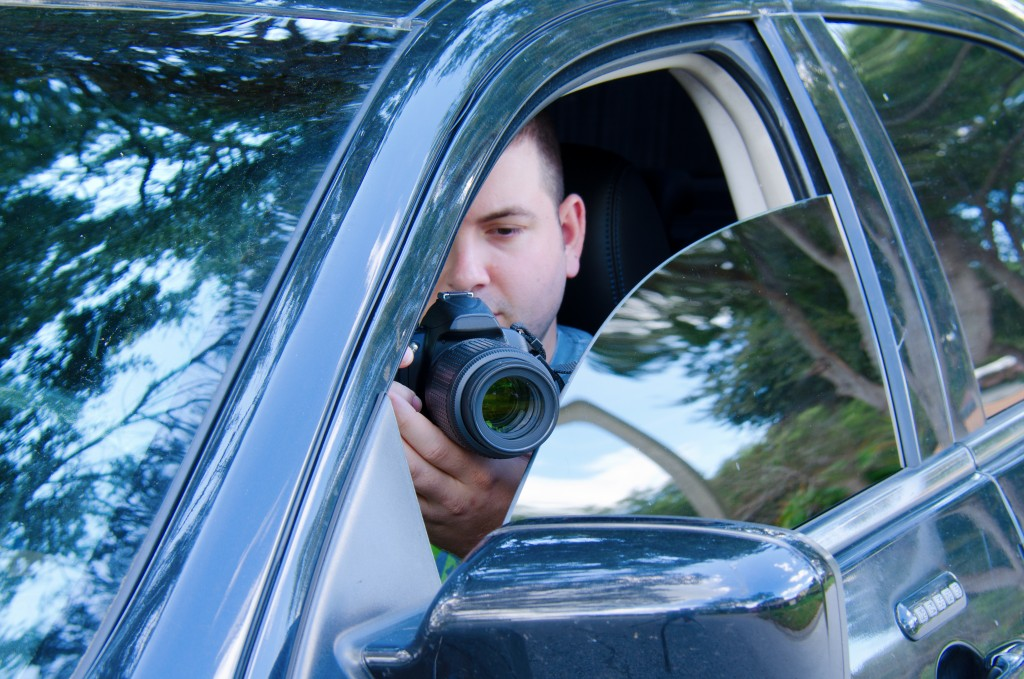Private investigator documenting using a camera