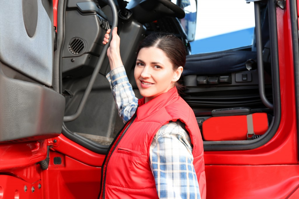 Female driver about to ride the truck