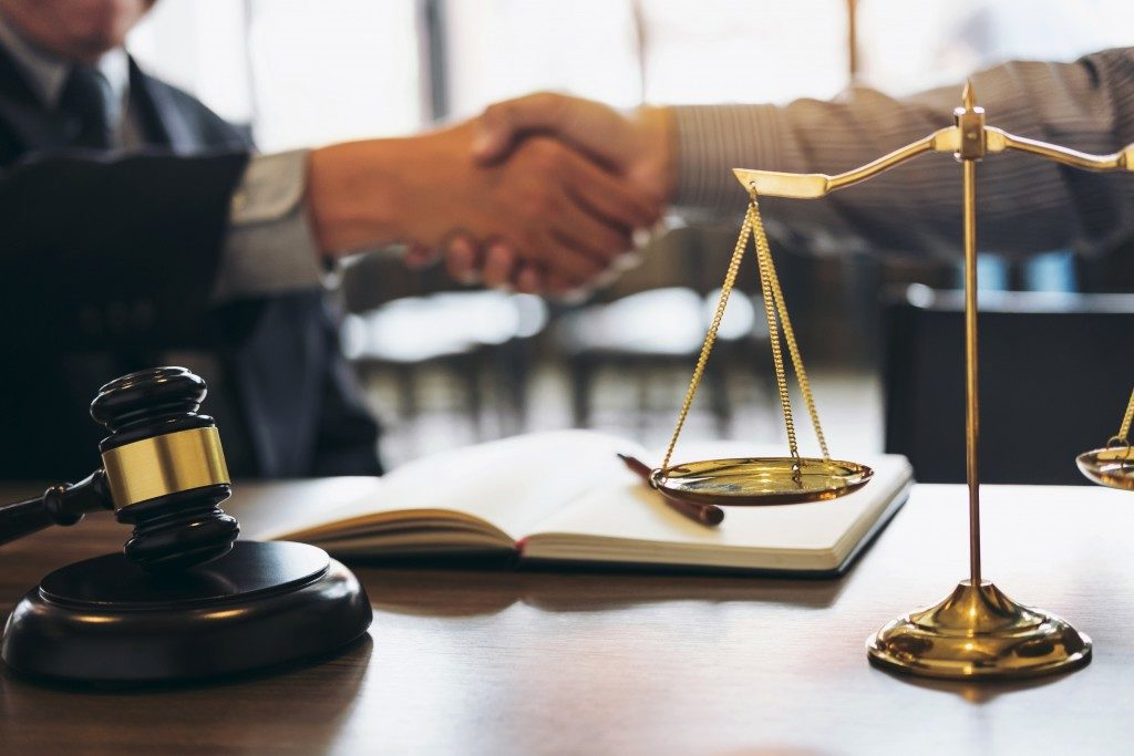 client and lawyer handshaking