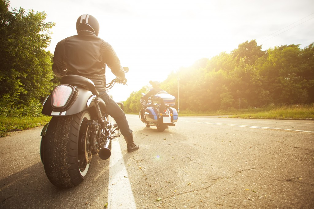 two bikers riding motorcycle in the highway
