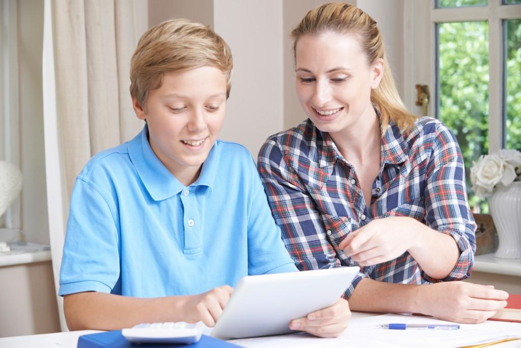 mother tutoring her son