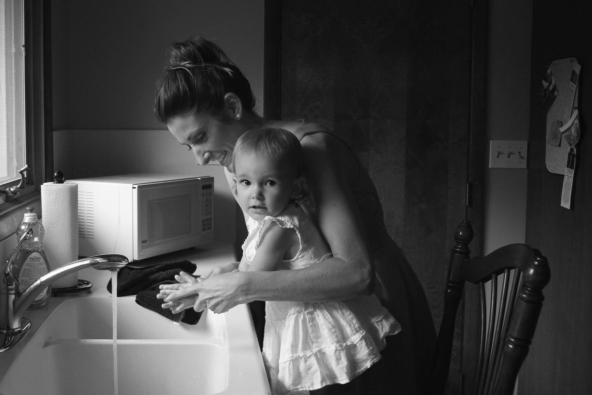 mother with her child at the kitchen sink