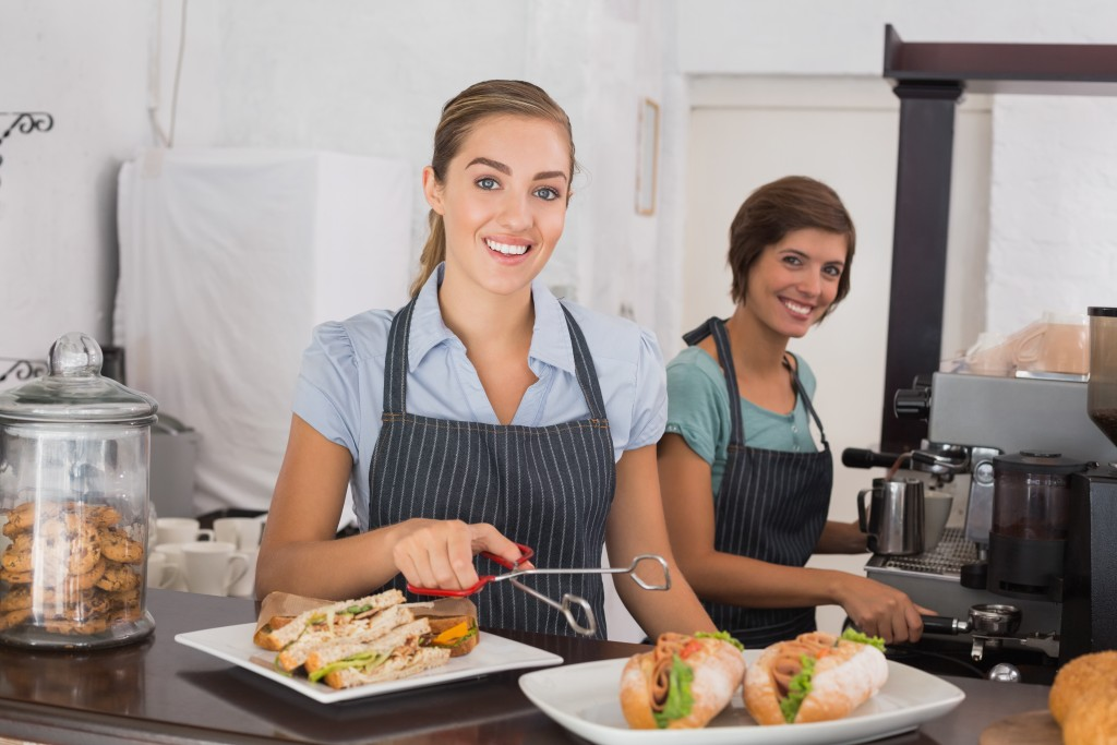 Women serving sandwiches