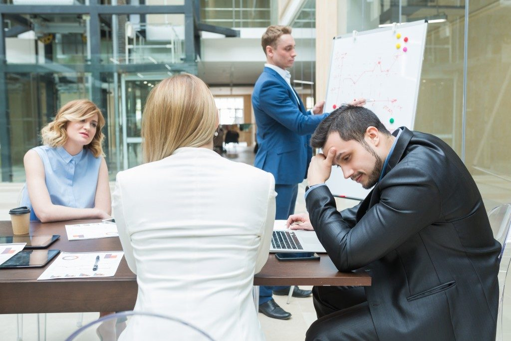 employees stressed inside the meeting room
