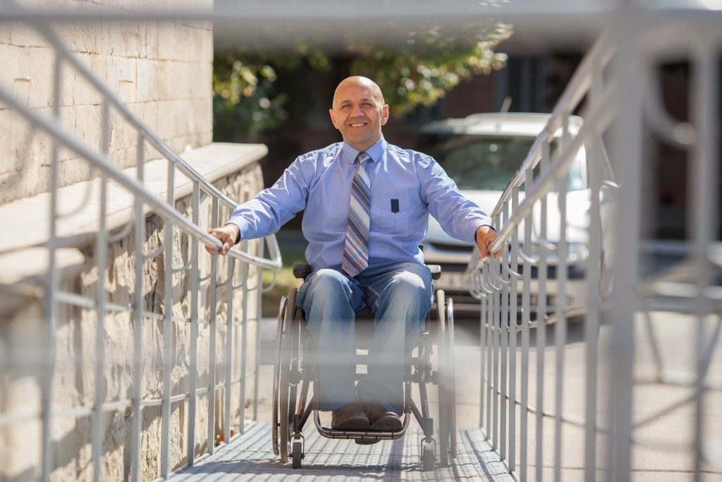Person on wheelchair going up ramp