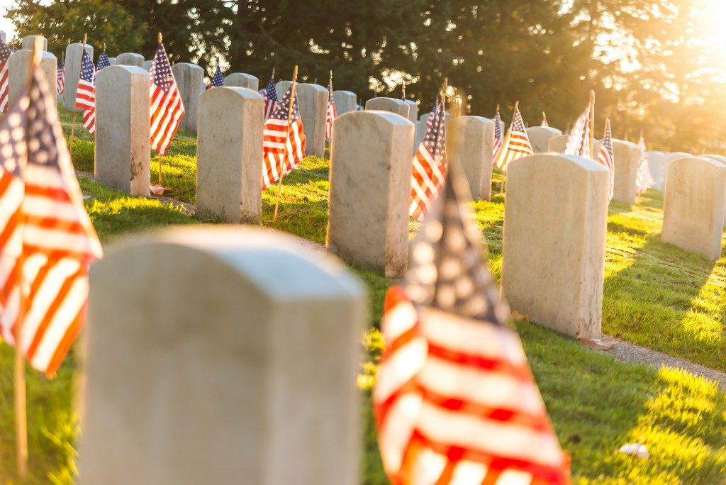 tombstones with American flags