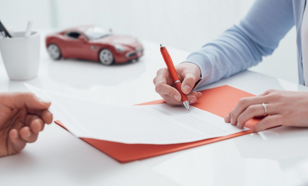 Signing document car loan