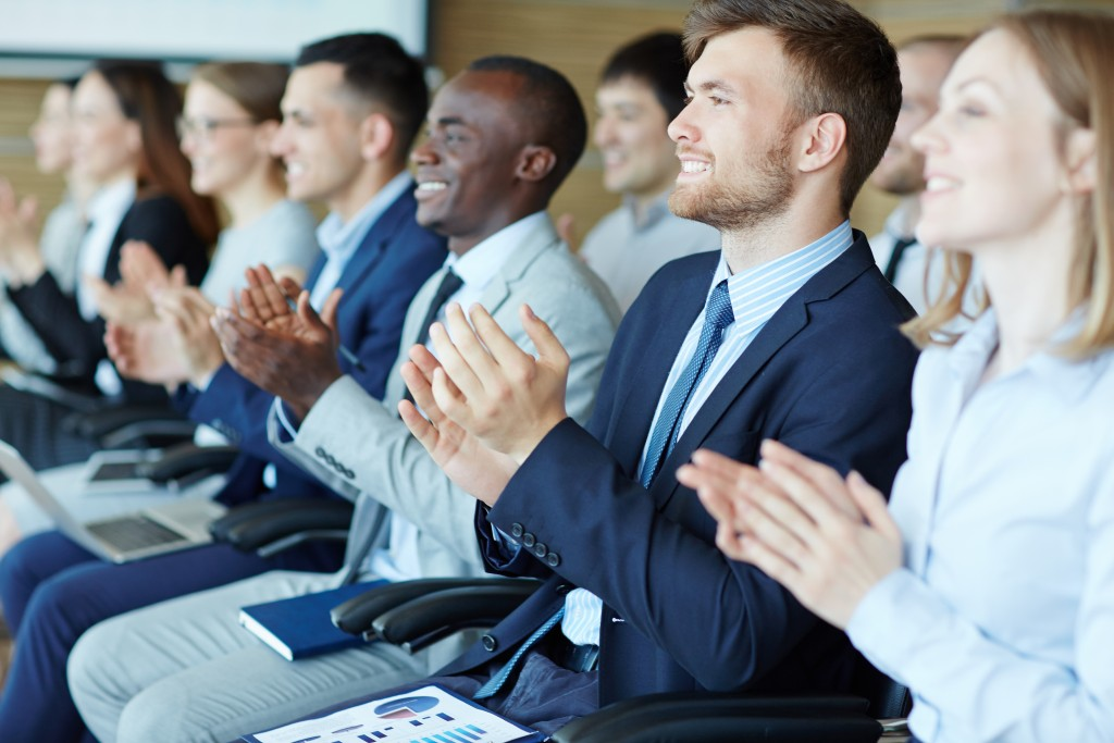 businesspeople clapping their hands