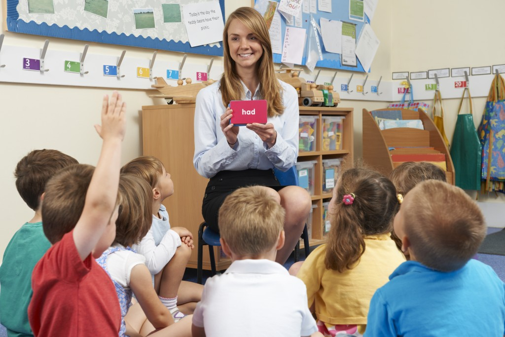 elementary students listening to their teacher