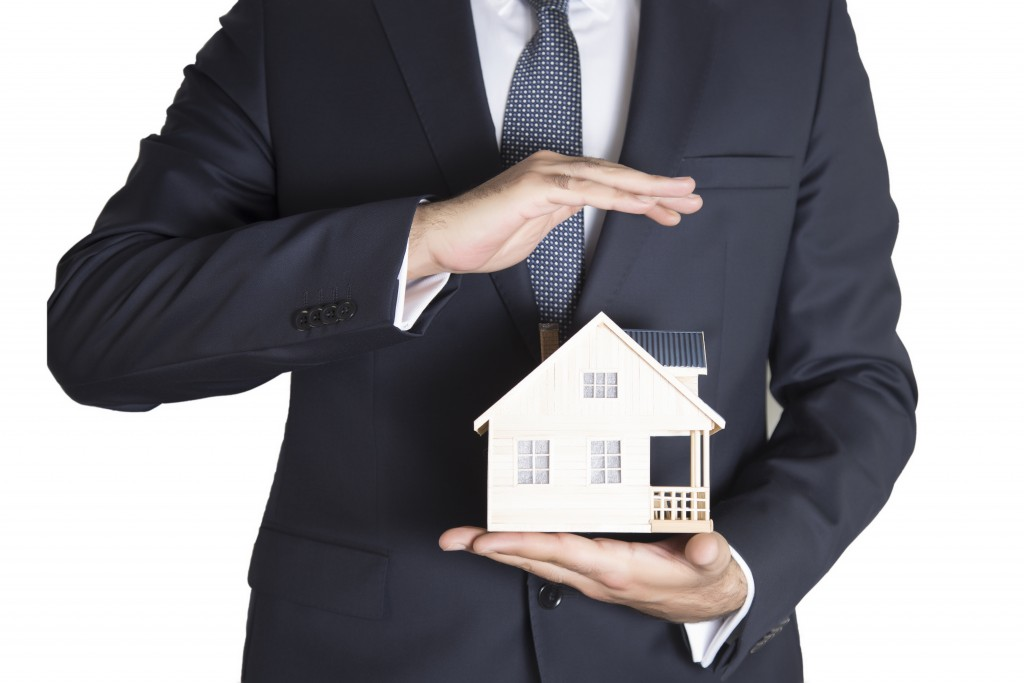 realtor holding a model house