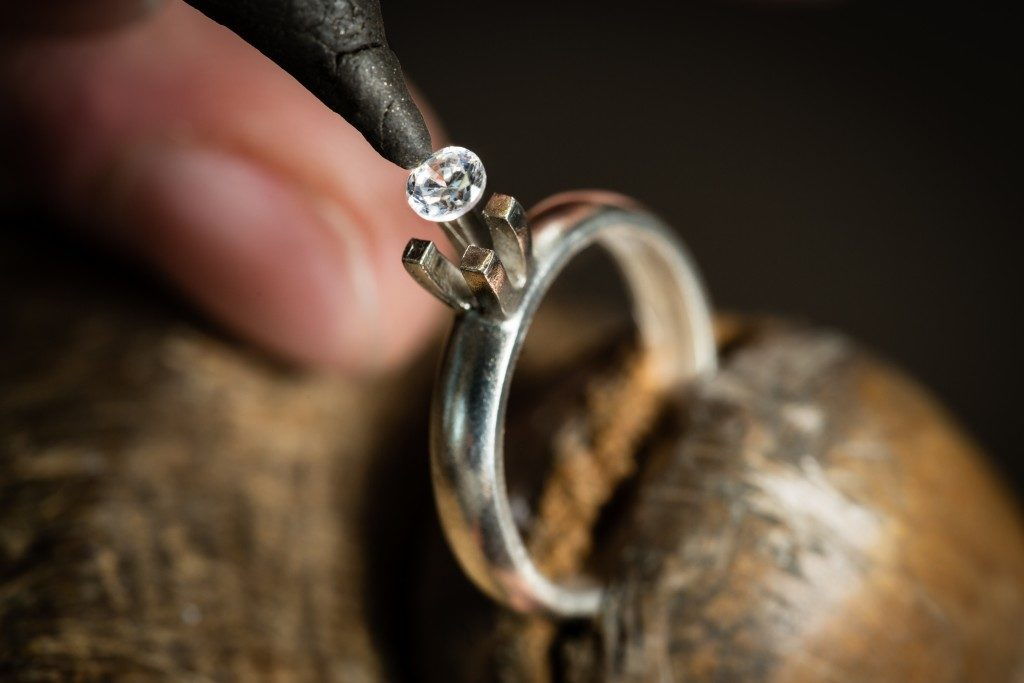 crafted ring placing diamond in the middle