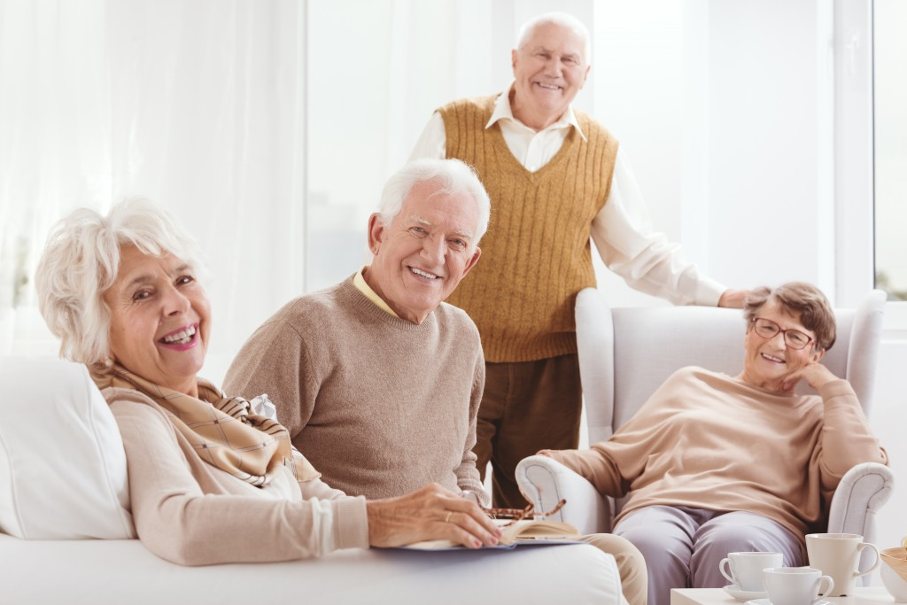 Elderly sitting on sofas