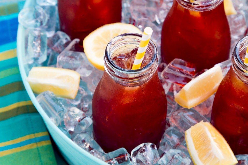 jars with juice on ice