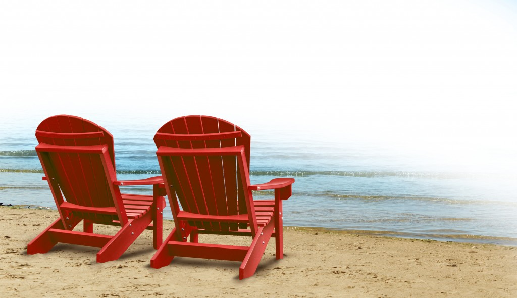red wooden chairs by the beach
