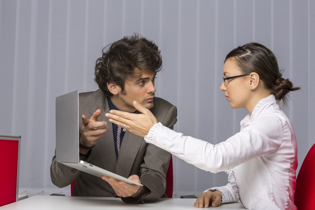 officemates arguing at the office