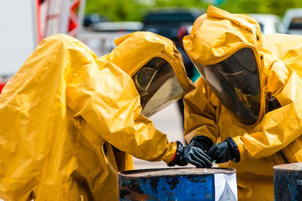 Two people wearing protective gear from chemical leak