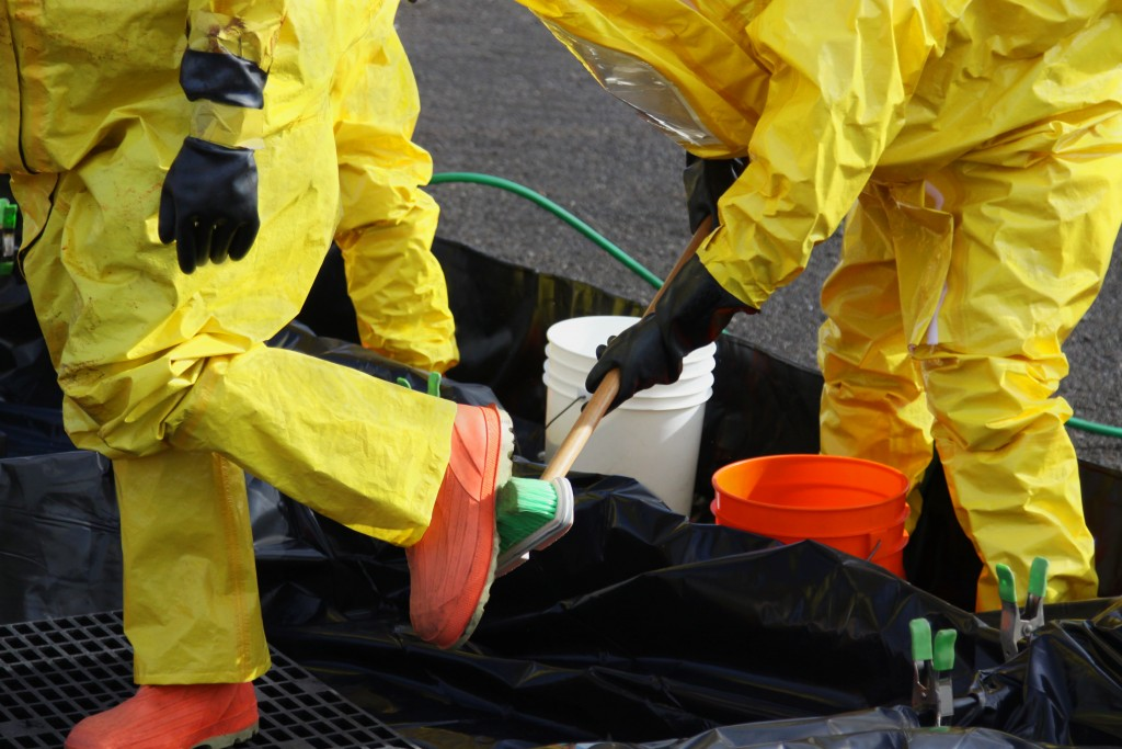 Men wearing protective gear for hazardous waste