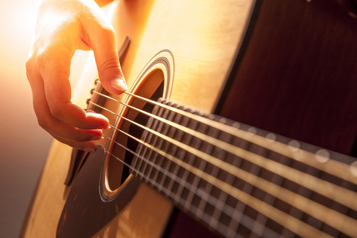 close up photo of acoustic guitar