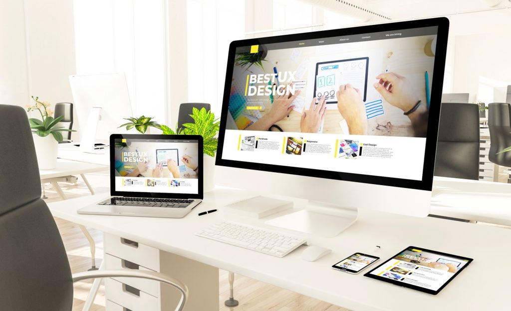 images of a website in different responsive specifications such as laptops, mobile, tablet and desktop computer