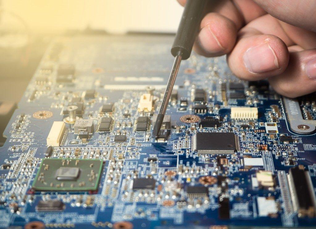 Closeup on electronic board in hardware repair shop