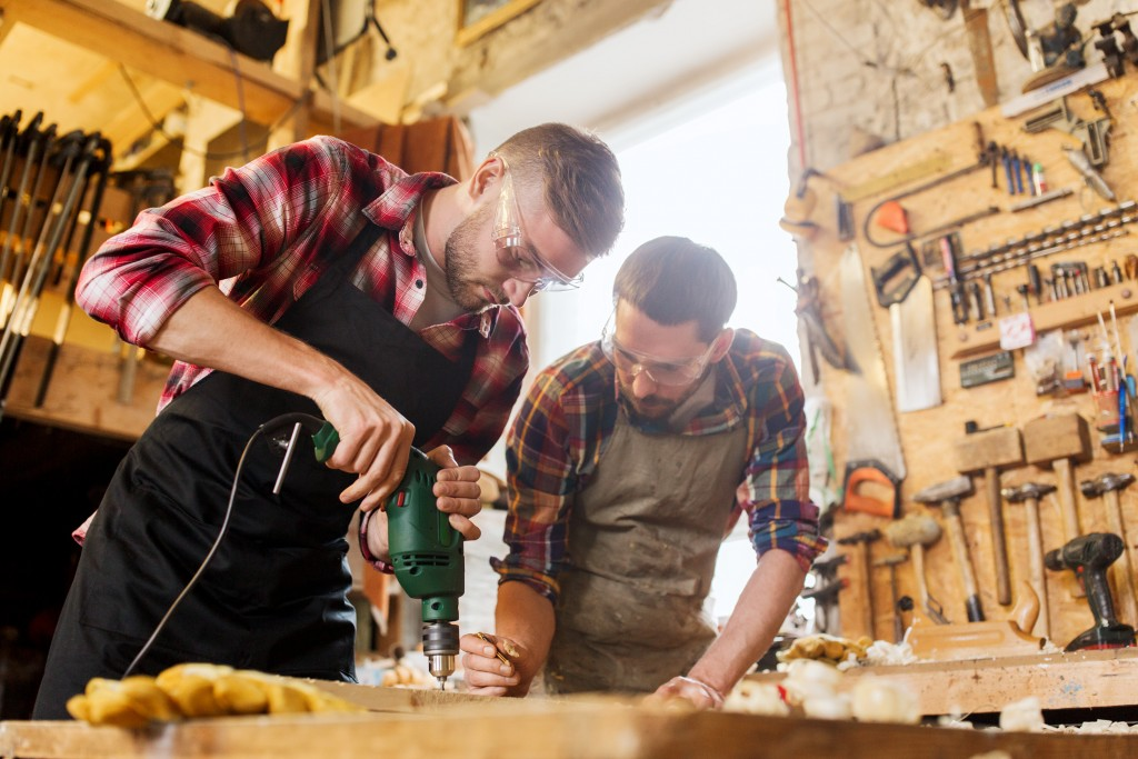 Carpenters wearing protective glasses