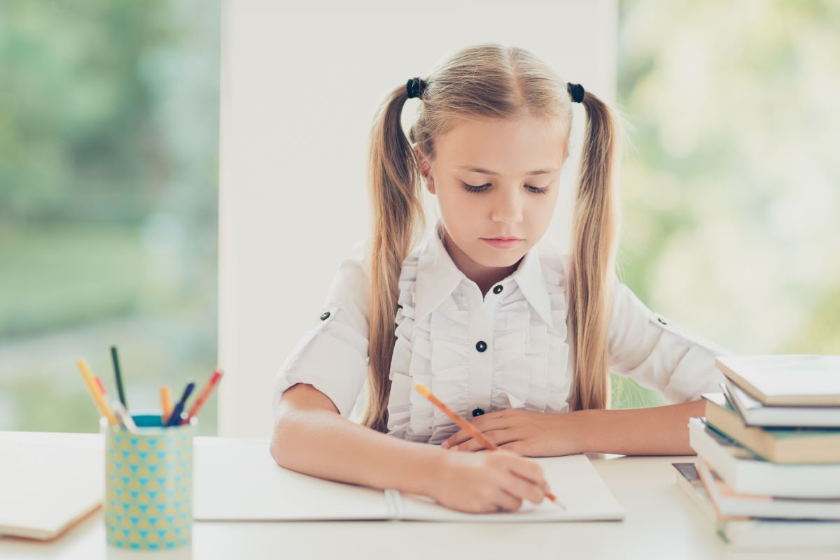 young girl taking down notes