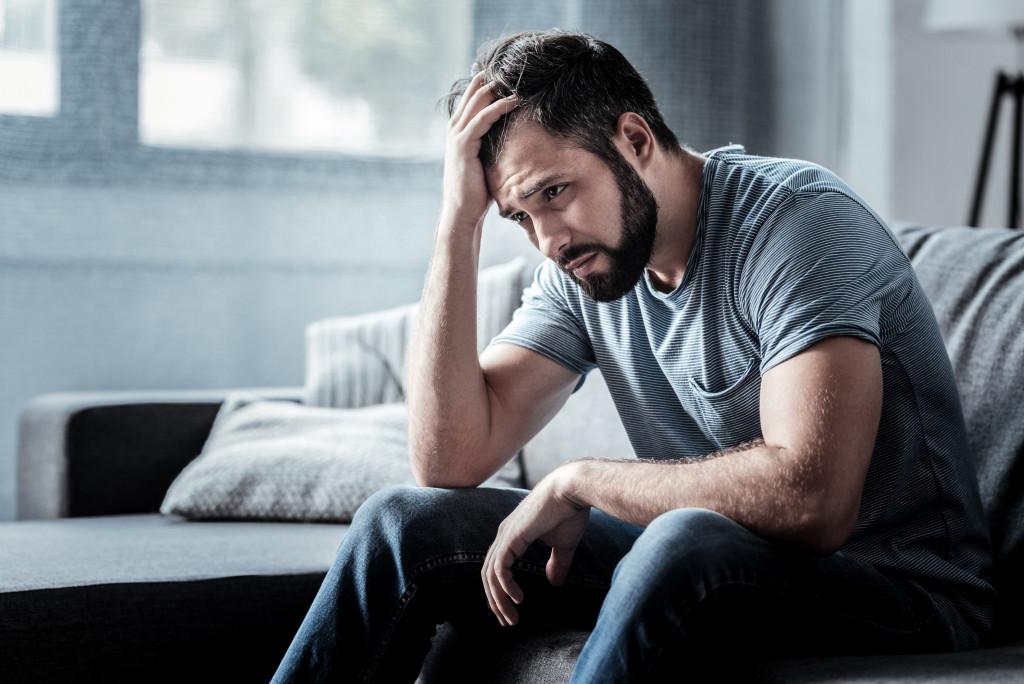 man suffering mental anguish